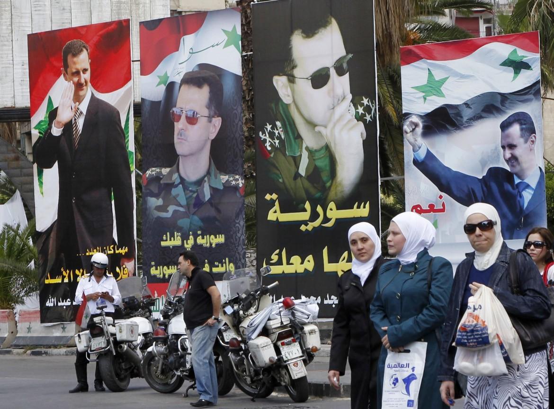 Poster del presidente Assad