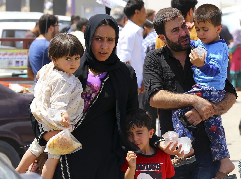 Profughi in fuga da Mosul