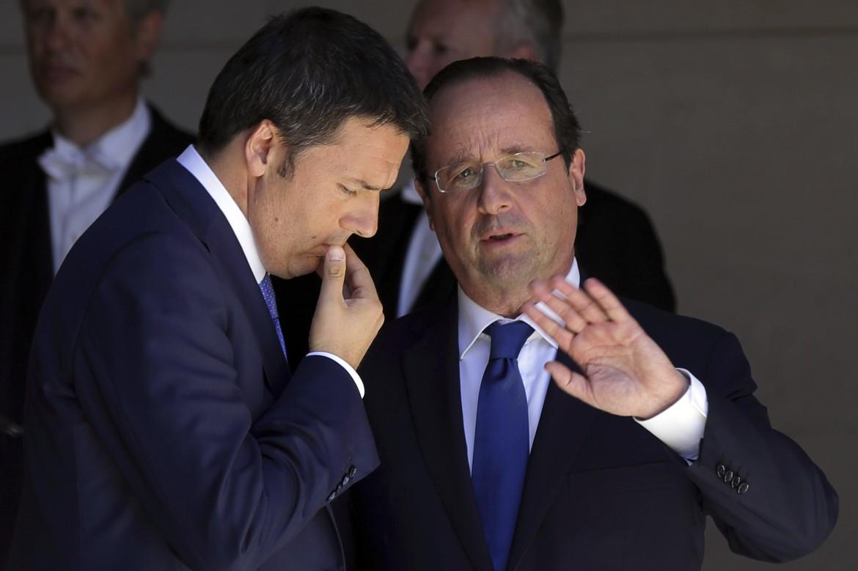 Renzi e Hollande in una foto del giugno scorso