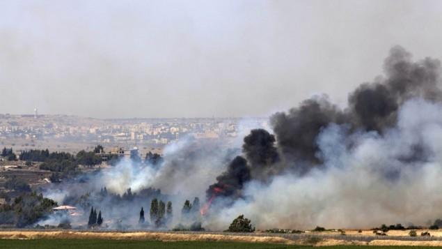 Golan, la città siriana di Quneitra durante combattimenti tra esercito siriano e ribelli