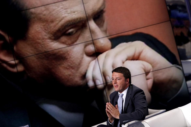 Renzi e, alle sue spalle, Berlusconi