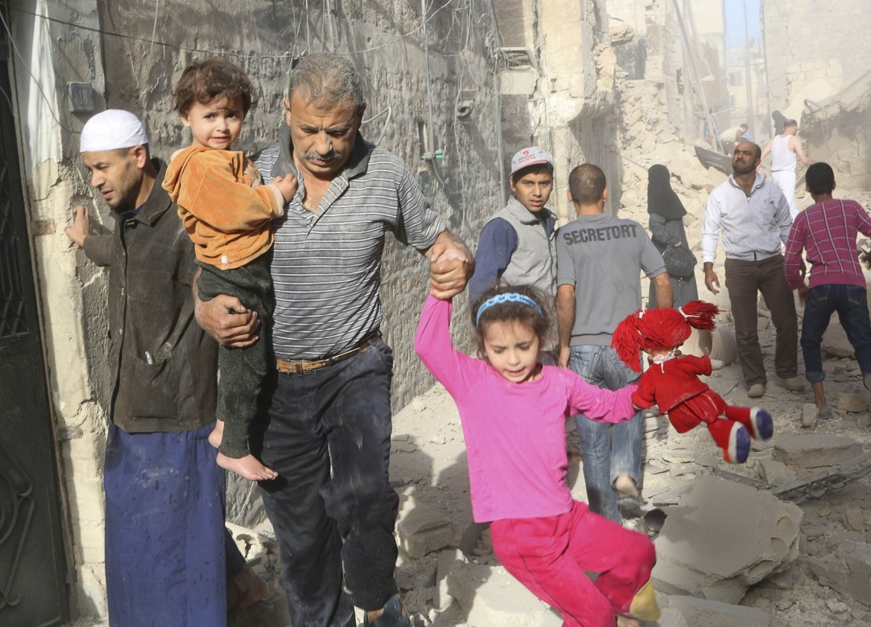 Civili in fuga in Siria
