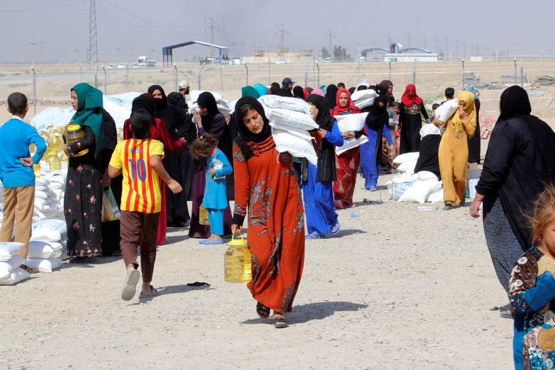 I primi sfollati di Mosul raggiungono Daquq