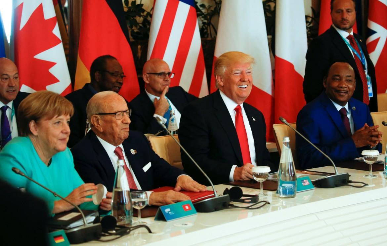 Trump con la cancelliera Merkel, il presidente tunisino Essebsi e il presidente nigeriano Issoufou