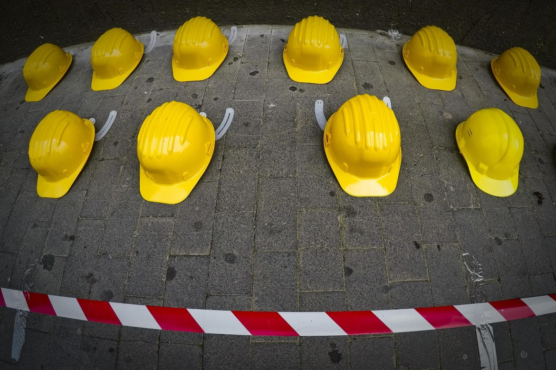 Una commemorazione dei morti sul lavoro nei cantieri edili