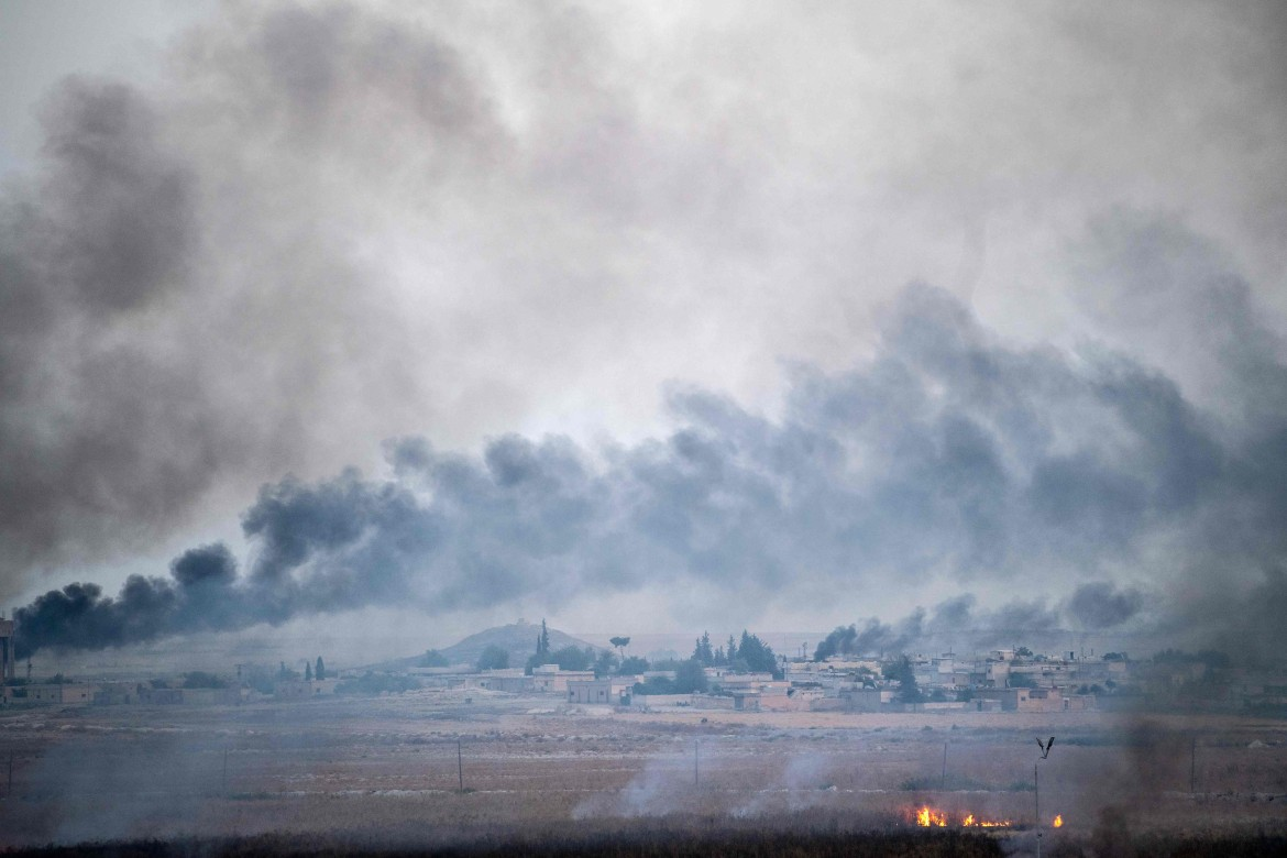 Smoke rises from the Syrian town of Tal Abyad, in a picture taken from the Turkish side of the border near Akcakale on October 10, 2019, on the second day of Turkey's military operation against Kurdish forces. - Turkey has vowed to destroy the Syrian Kurdish People's Protection Units (YPG) which controls much of northeastern Syria, and set up a