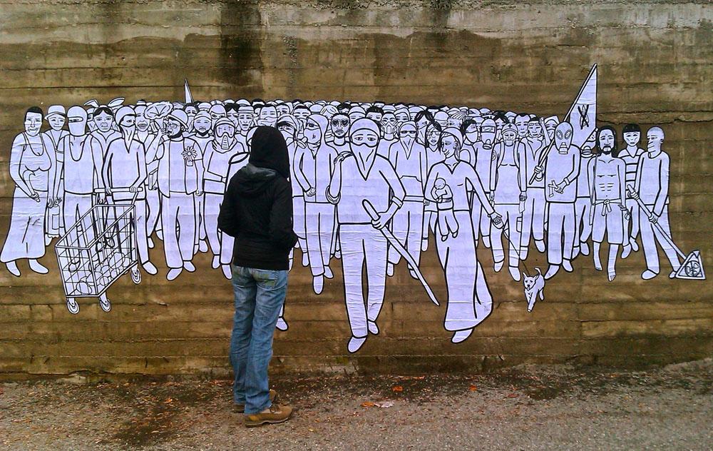 Un Quarto Stato Notav su un muro di Giaglione, in Val di Susa, opera di Gec.