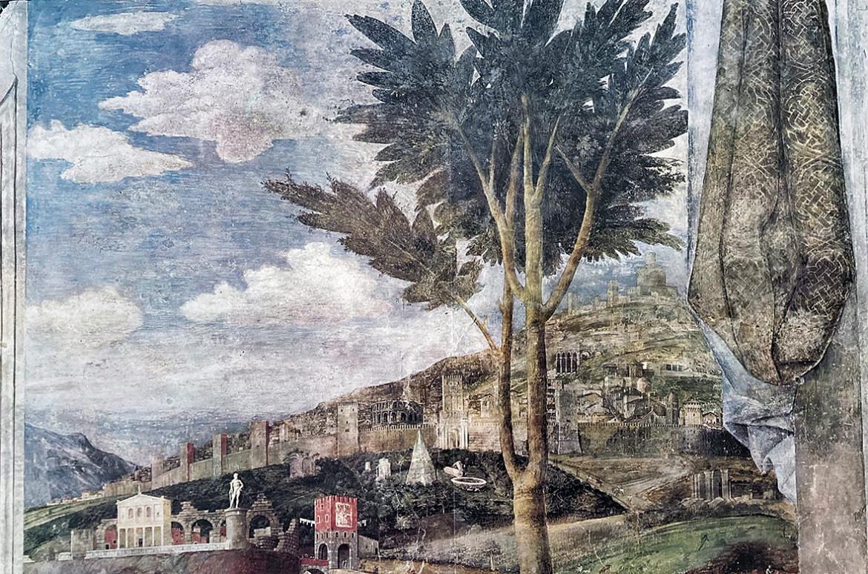 Andrea Mantegna, Camera degli Sposi  a Mantova: particolare delle mura cittadine  di una Roma immaginaria, che fanno da sfondo  alla scena dell'incontro  tra Ludovico Gonzaga  e il figlio, il Cardinale Francesco