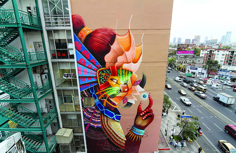Un murales di Curiot in una strada di Città del Messico