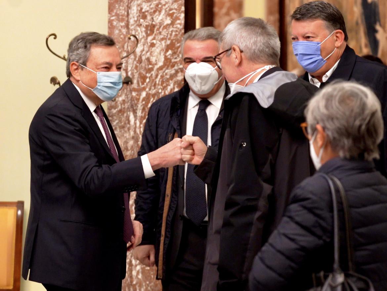 Il premier Mario Draghi e il segretario della Cgil Maurizio Landini